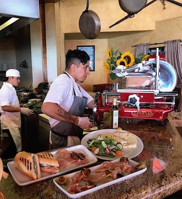 Slicing prosciutto di parma at Locanda del Lago