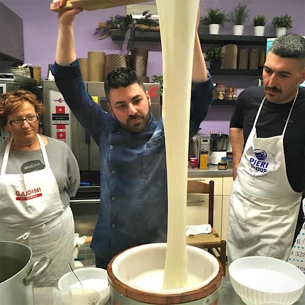 mozzarella being pulled
